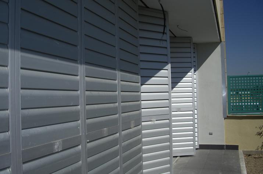 Celosías de aluminio con marco practicable familia